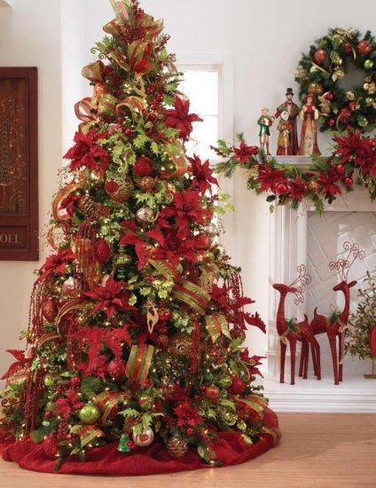 another christmas classic the poinsettia tree is both easy to decorate and magnificent just get as many artificial red and golden poinsettias as your tree