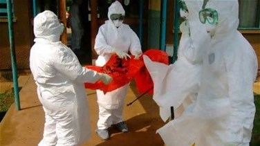 Ebola deaths at 4,877 as...