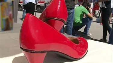 REPORT: Lebanese men wear red heels; participate in the Walk a Mile in Her Shoes campaign