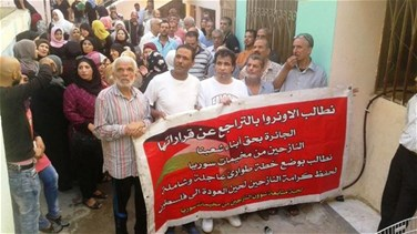 Palestinians from Syrian refugee camps protest outside Beddawi Camp