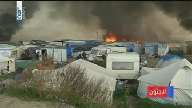 "REPORT: Sun rises on charred ""Jungle"" as Calais migrants keep leaving"