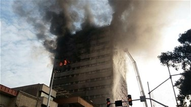 Lebanon News - [PHOTOS] At least 38 firefighters hurt as blazing Tehran building collapses -Iranian state TV