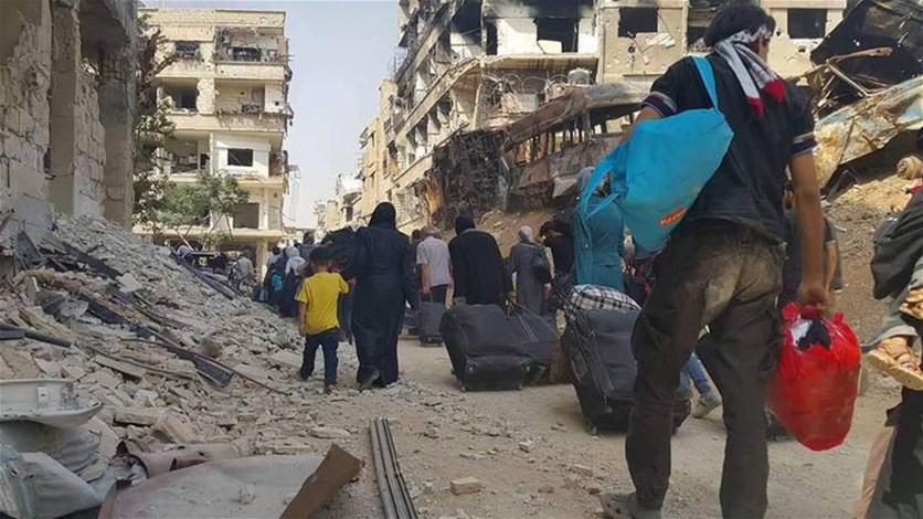 Syrian rebels, families evacuate besieged town near Damascus