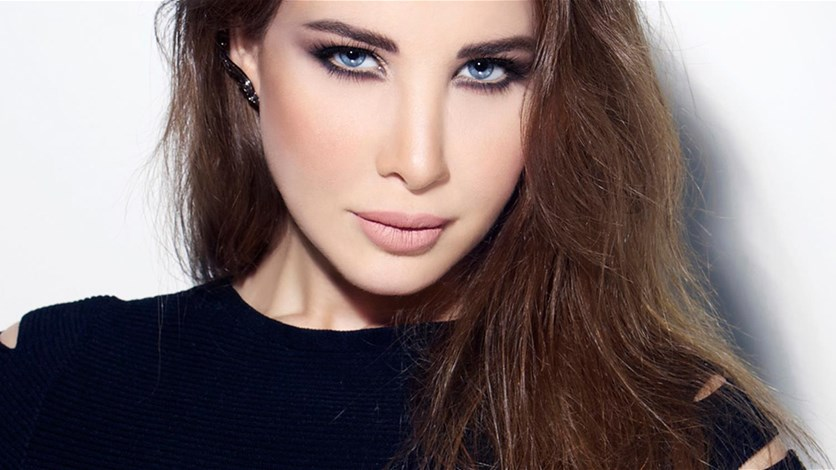 """db0ed6b47 نانسي عجرم بالفستان الأبيض في """"الحب زي الوتر""""... وهذه تفاصيل.  LBCI News Lebanon"""