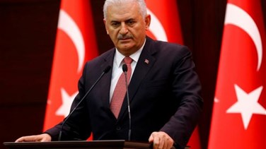 Turkey PM says aims to develop relations with Syria, Iraq