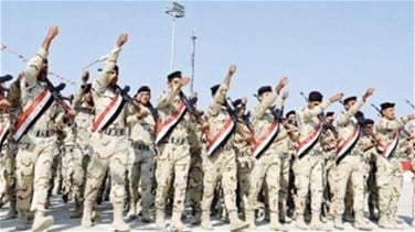 Iraqi armed forces, Shi'ite paramilitary units parade in...