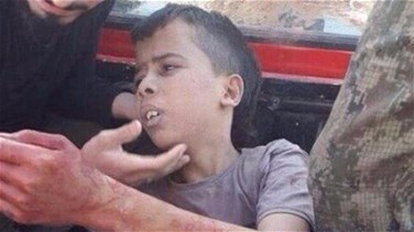 [PHOTOS] Syrian rebel group says investigating child beheading...