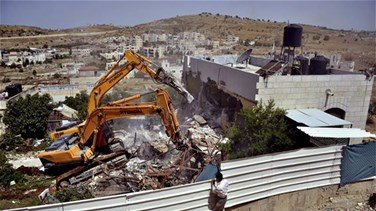 Israeli military demolishes home of Palestinian attacker who...