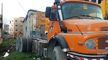 Worker killed after tire of a concrete mixer truck explodes in...