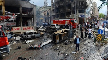 Car bomb in Syrian town near Turkey border kills at least 13-...