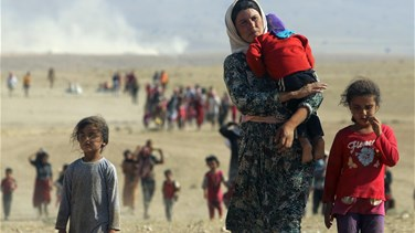 In northern Iraq, Yazidis risk all to flee Islamic State