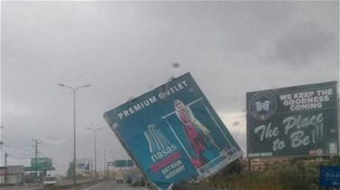 Huge billboard falls on Batroun highway during strong winds
