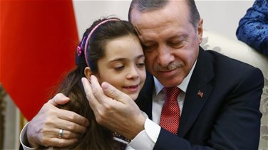 Syrian girl, 7, who tweeted from Aleppo meets Turkey's...