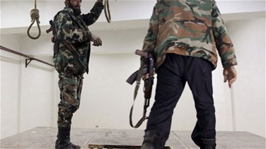 REPORT: Syria carried out mass hangings at military prison -...