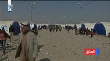 REPORT: Hundreds of Iraqis struggle in muddy roads to flee Mosul...