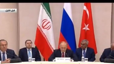 REPORT: Russia's Putin says Iran, Turkey back proposed Syrian peoples' congress