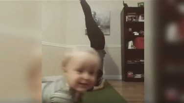 VIDEO - Little Boy Hilariously Photobombs Mum Trying To Film Yoga Moves At Home