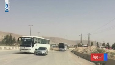 Popular Videos - REPORT: Buses carrying Syrian rebels and families begin to leave east Ghouta's Harasta