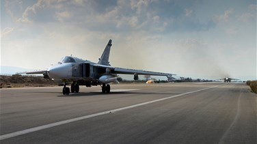 Russia says it repelled an attack on its main Syrian air base -...