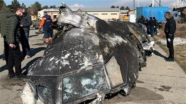 Popular Videos - Iran seeks help reading downed plane's black boxes in new standoff