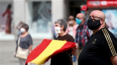 Related News - With black masks and silence, Spain mourns its coronavirus dead